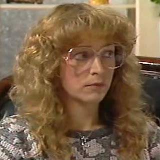 Diedre Barlow's perm and big glasses in the 80s
