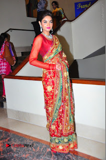 Model Sharon Fernandes Stills in Red Saree at Trendz Exhibition Launch  0053.JPG