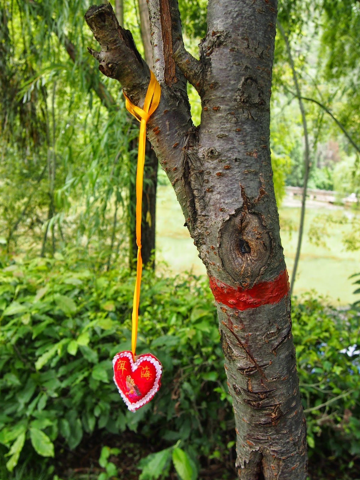 A heart ornament on a tree