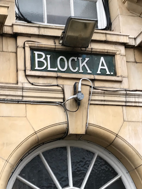 Signage on the Peabody houses, Lillie Road, London