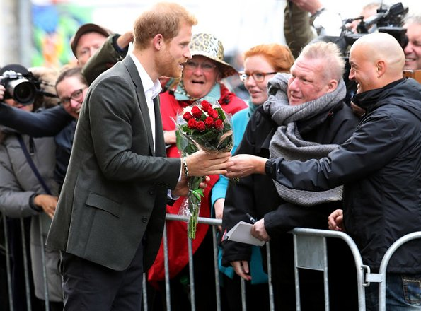 Prince Harry receives flowers as he arrives to a Start-Up Business event at KPH Projects in Copenhagen