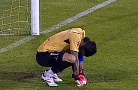 Red Star goalkeeper Boban Bajković reacts after conceding a bizarre goal against Jagodina