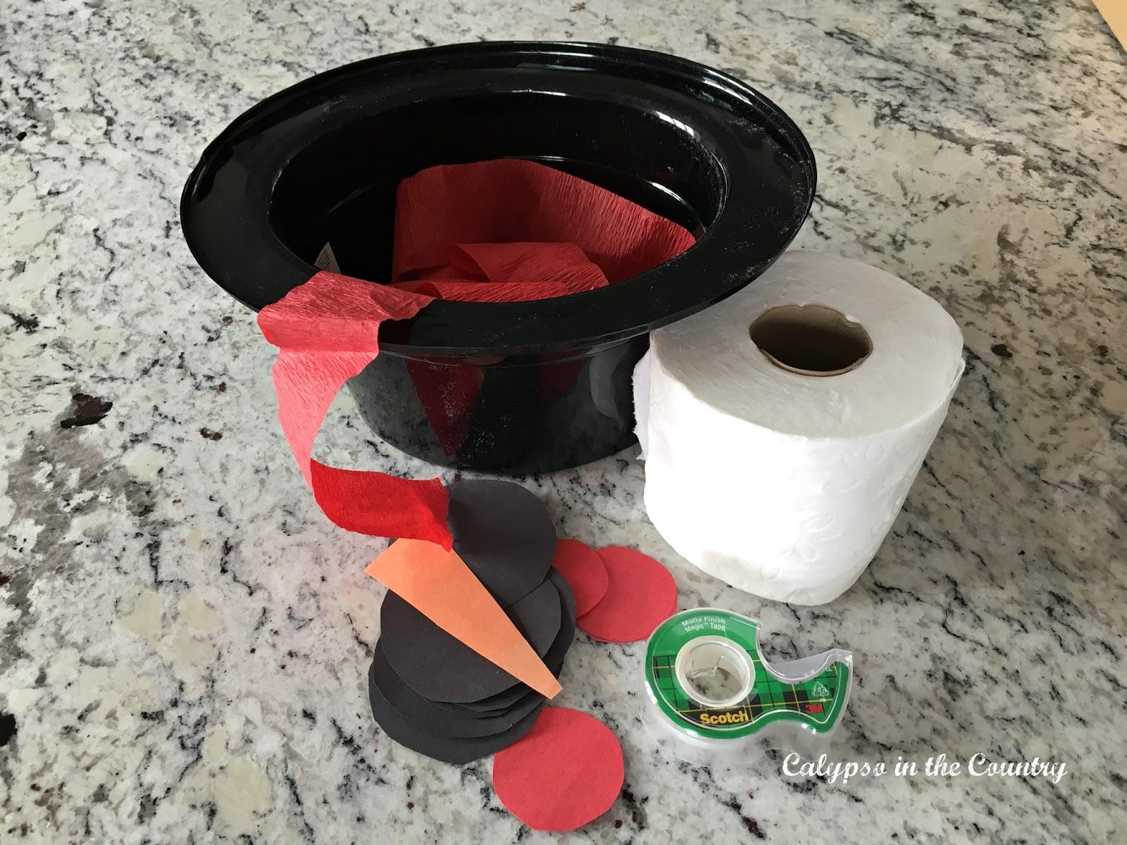 Snowman supplies to build a toilet paper snowman