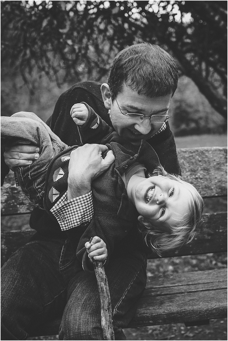A father and young son laughing together