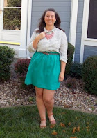 an outfit with a teal skirt, striped shirt, pink necklace, and cognac flats