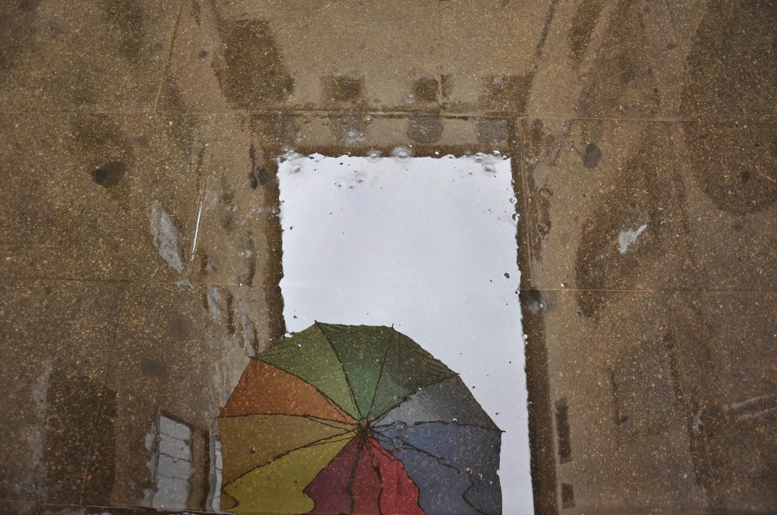 umbrella reflection puddle courtyard palazzo Vicenza