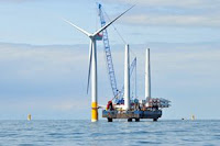 Offshore wind turbine under construction (Lead image credit: SSE | Flickr) Click to Enlarge.