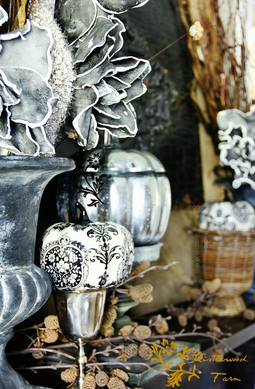 These silver pumpkins and painted pumpkins are a modern twist on fall decor.