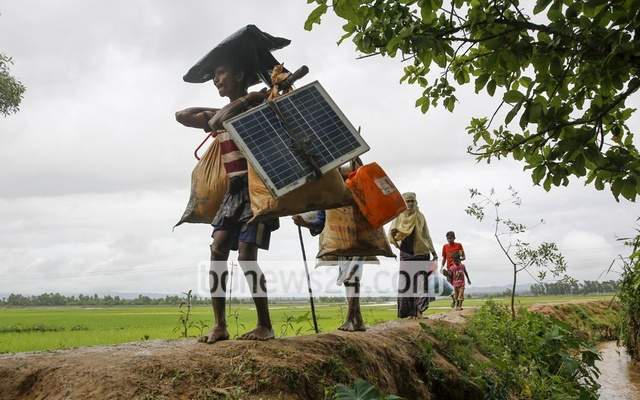 Refugees reported an arduous trek of 5 to 15 days along hilly and waterlogged roads, but that did not stop many of them from carrying a solar panel.