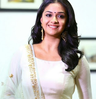 Keerthy Suresh in White Dress with Cute and Awesome Lovely Chubby Cheeks Smile