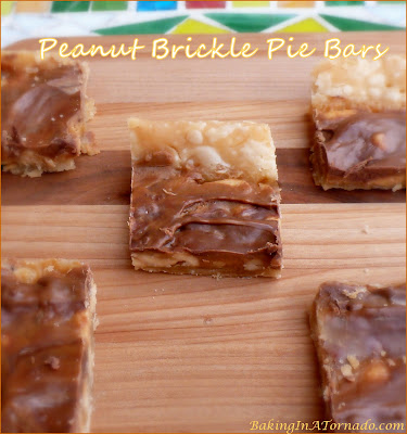 Peanut Brickle Pie Bars, made in a pie crust, have a chewy peanut brickle center, topped with a chocolate peanut butter glaze. | Recipe developed by www.BakingInATornado.com | #recipe #dessert