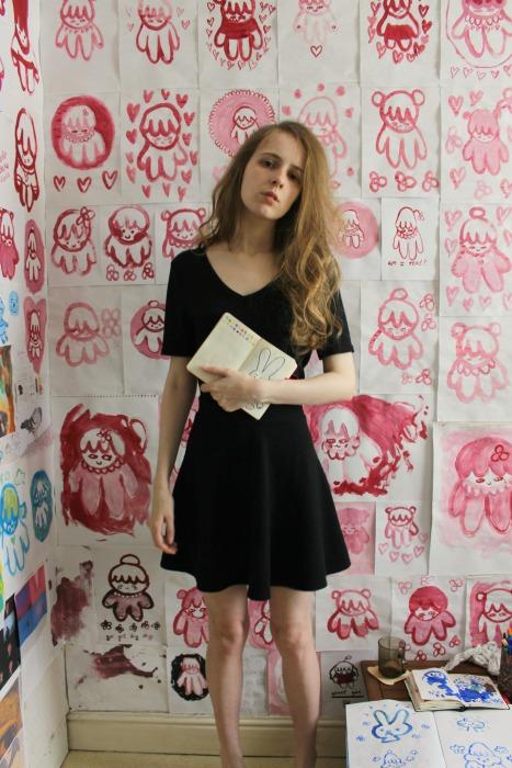 Full shot of girl holding an open journal.