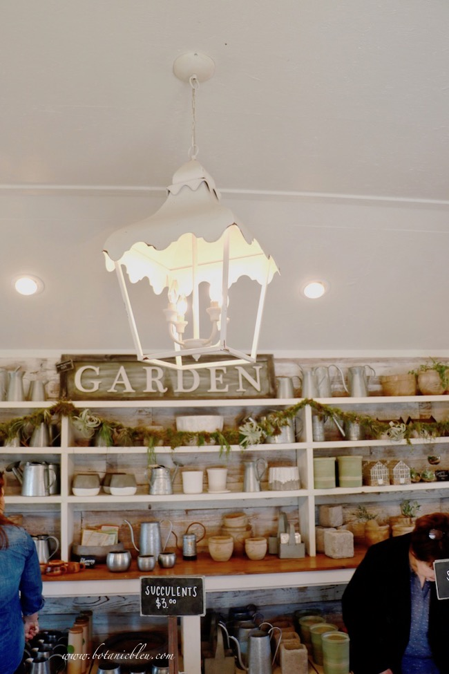 Magnolia Garden Shed Shelves and White Hanging Ceiling Lantern