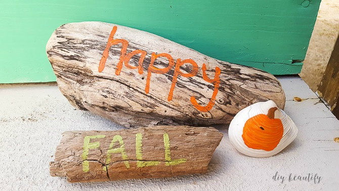 painted driftwood and pumpkins