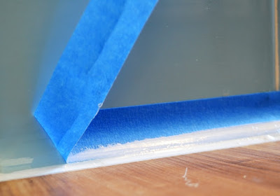 Peel away tape to reveal smooth straight caulking
