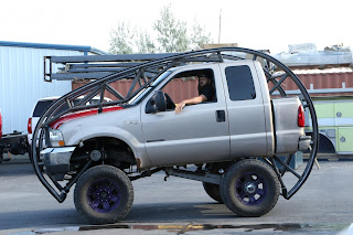Heavily-modified pickup truck somersaults