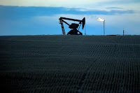 A pump jack and natural gas flare near Williston, N.D. (Credit: Eric Gay/Associated Press) Click to Enlarge.