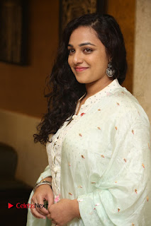 Actress Nithya Menen Latest Pictures in White Dress at 100 Days of Love Movie Audio Launch  0047