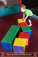 three year old builds with giant foam blocks