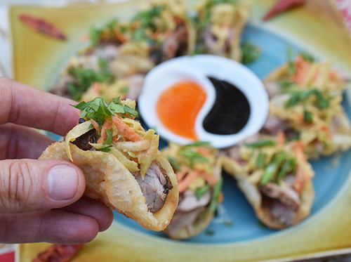 This recipe for Teriyaki Pork Mini-Tacos with Thai Peanut Slaw is crispy and delicious.