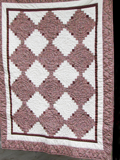 brown and cream log cabin quilt  donated to community service