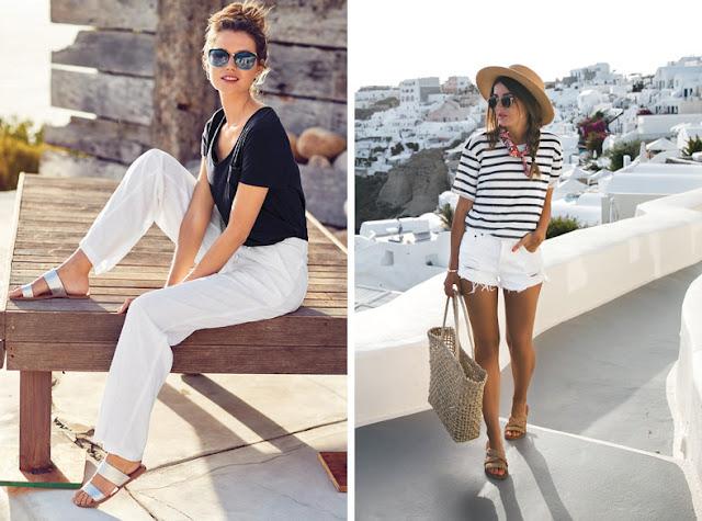 Девушка в шортах и белых брюках в мюлях на плоской подошве