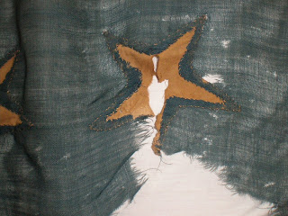 Flag conservation by conservator Gwen Spicer, historic flags, silk, damage