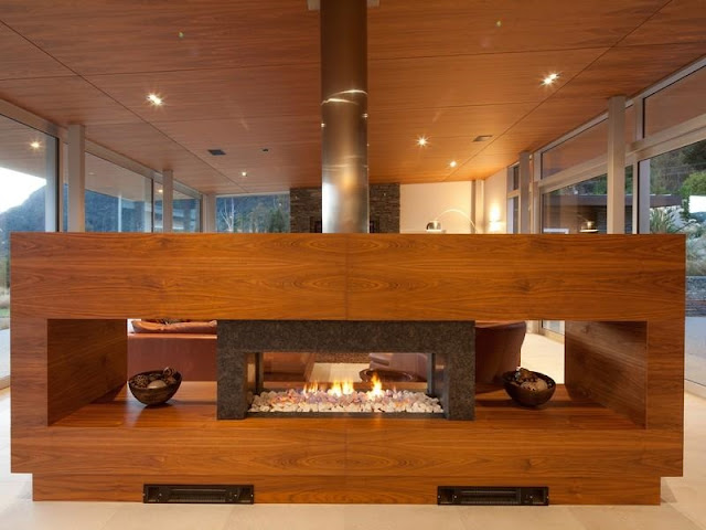 Wooden fireplace in the glass house