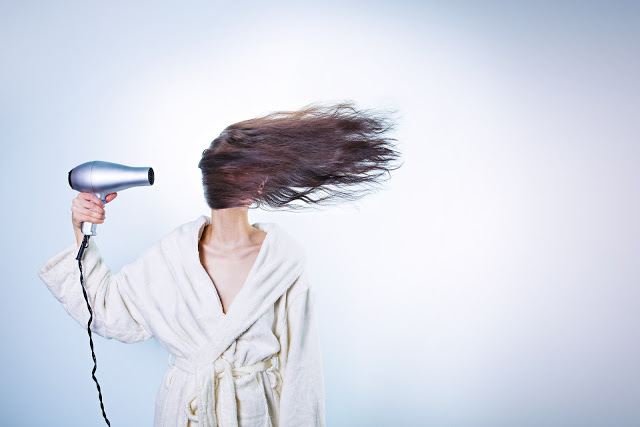 woman hairdryer windy hair