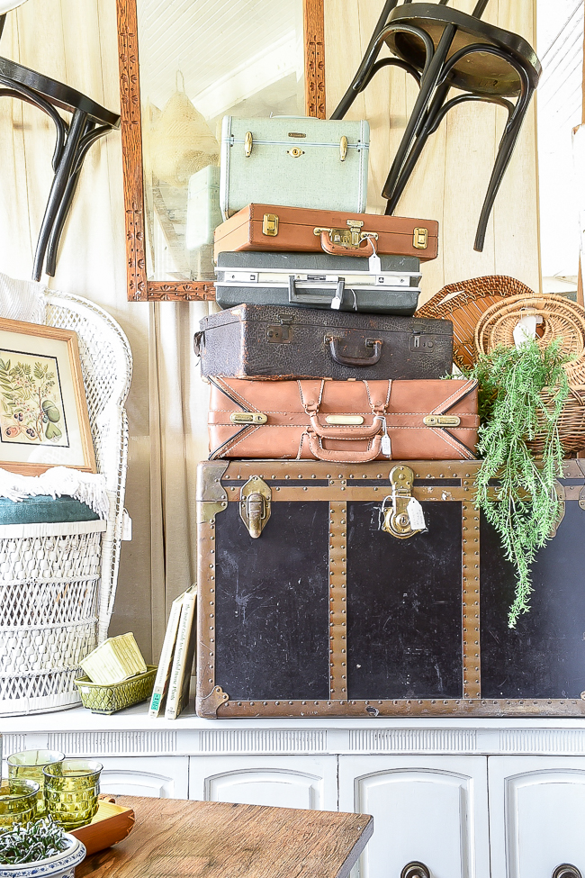 steamer trunk stacked with vintage suitcases