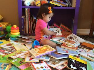 B reading amongst pile of books here
