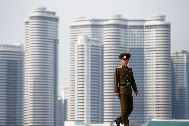 Image Attribute:  A soldier walks on the bank of the river in central Pyongyang, North Korea April 16, 2017.    REUTERS/Damir Sagolj