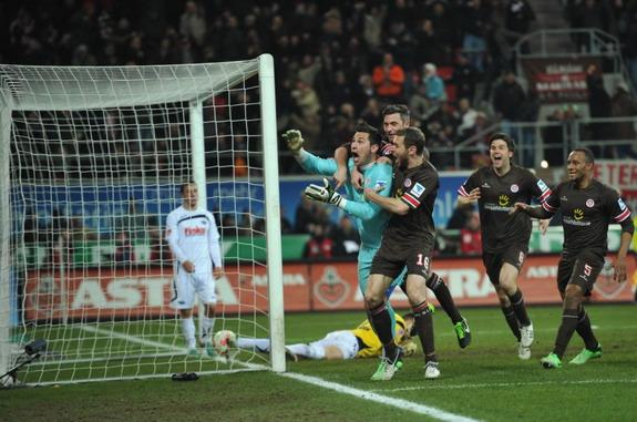 Nürnberg player Timmy Simons shoots to score a goal against Wolfsburg