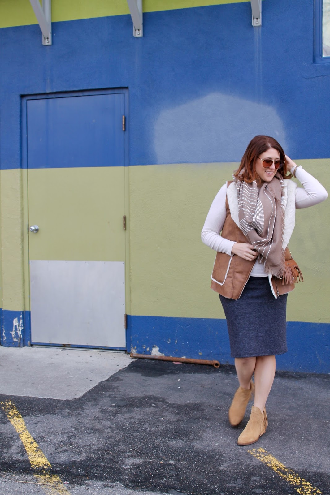 easy outfit, faux shearling vest, blanket scarf, casual outfit, comfortable outfit ideas, fringe boots, red bob hair