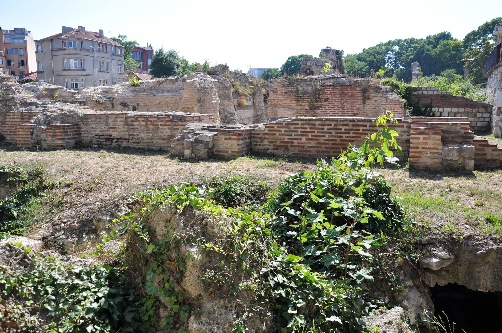 Ancient ruins surrounded by contemporary buildings, The Roman Thermae, Varna, Bulgaria
