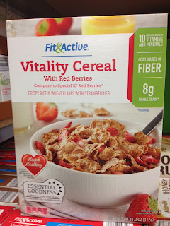 An unopened box of Fit & Active Vitality Cereal with Red Berries sitting on an Aldi shelf