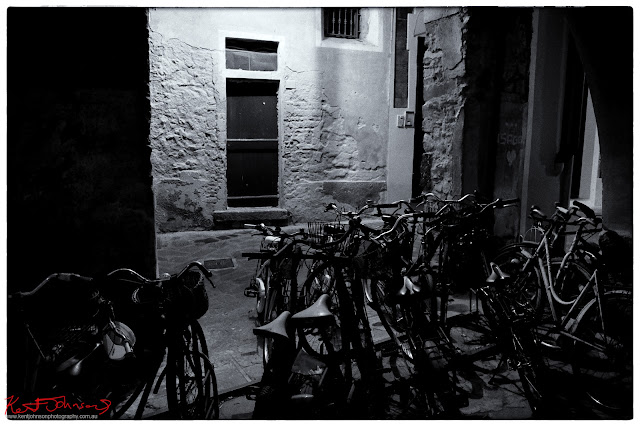 a peloton of bicycles, old town, Monterosso al Mare. Photograph by Kent Johnson