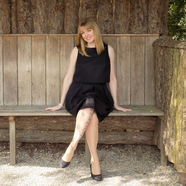 Little black dress and butterfly tatoo tights