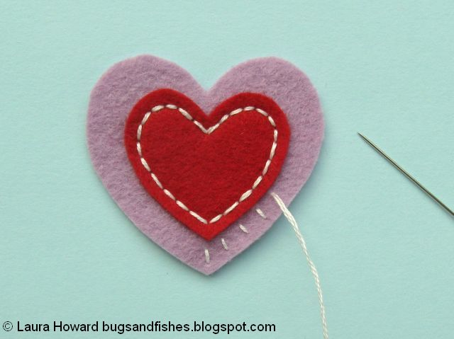 Embroidering the felt heart