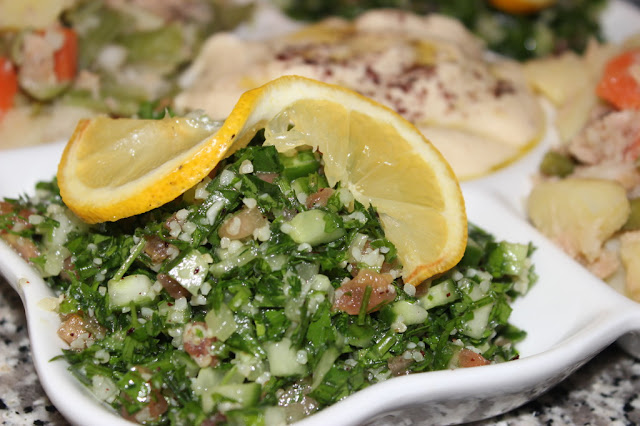 Arabic Tabouleh Salad in a Platter Decorated by Lemon slice Arabic Tabouleh Salad Recipe
