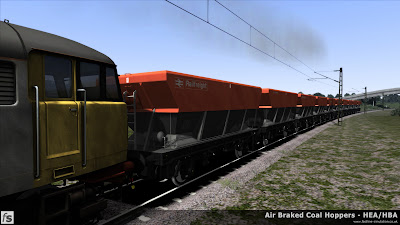 Fastline Simulation - HBA/HEA Coal Hoppers: In Train Simulator 2013 shot of HBA and HEA hoppers in Railfreight Flame and Grey livery testing numbering and lettering arrangements. Still some texture work to complete before the master versions are finished along with making the maroon versions