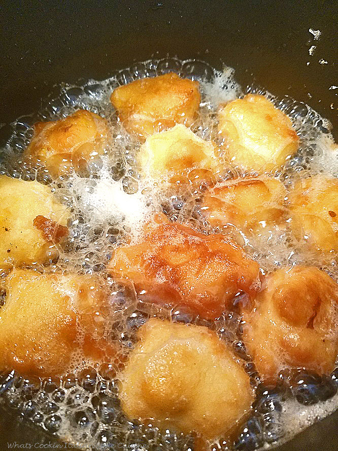 these are old fashioned corn fritters frying in oil. They are a miniature version of the old fashioned large corn fritters made smaller deep fried in hot oil