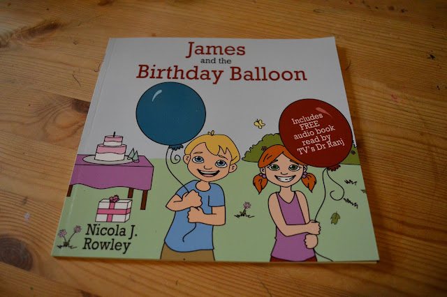 Two children on a book cover with a red and a blue balloon.