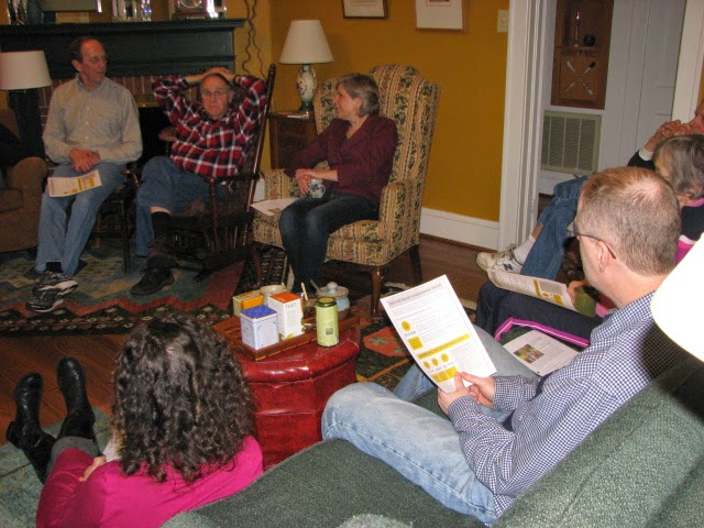 JCC members gather in the Smith's living room in discussion
