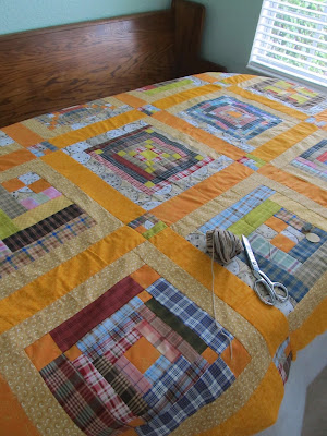 Log cabin quilt tied with yarn