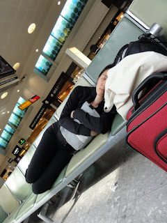 Napping at Heathrow Airport (Photo courtesy of Alvin C.)