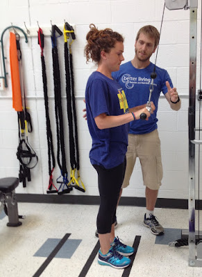 Better Living personal trainer Eduard Font works with our newest nutrition counselor, Becca Addison, during a recent workout in Ann Arbor.