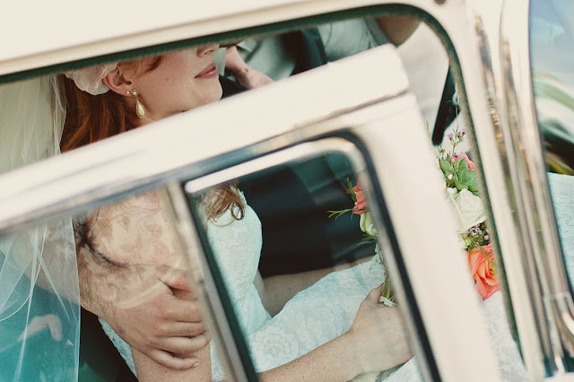 woman wearing white wedding gown inside white car