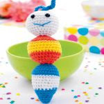 http://www.topcrochetpatterns.com/images/uploads/pattern/Crochet-caterpillar-rattle.pdf
