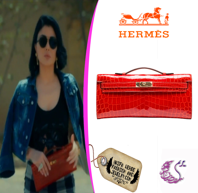 Haifa Wehbe appeared carrying this Hermes Sanguine Shiny Porosus Crocodile  Kelly Cut Clutch in one of the scenes of Mariam. Haifa Wehbe s addition of  color ... dcf7596ce7661